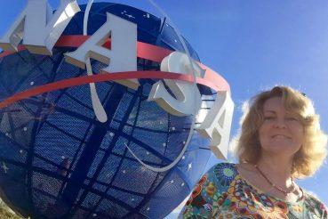 me beside giant NASA globe